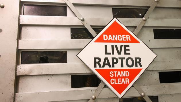 Warning sign of Live dinosaur inside big box