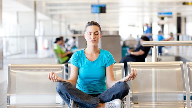 woman meditating at airport