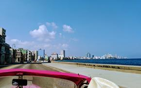 Driving down the Malecon in Havana, Cuba