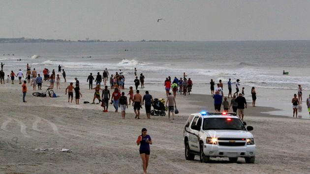 Florida Beaches reopen Associated Press