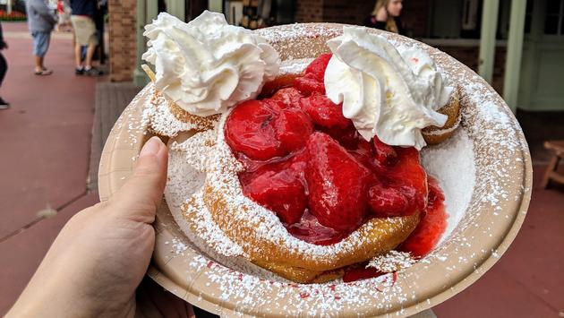 Mickey Waffle topped with strawberries and whipped cream from Sleepy Hollow at Liberty Square in Magic Kingdom