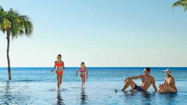 Receive Instant Savings up to $300, $200 in Resort Coupons + Kids Stay Free at Dreams Resorts & Spas