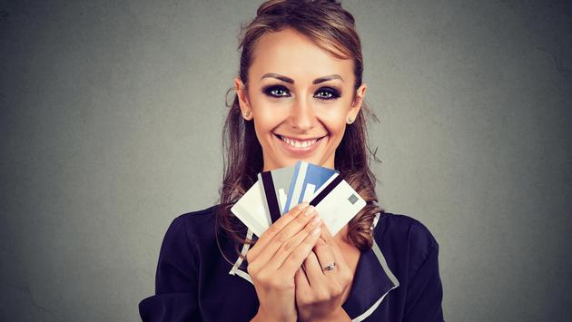 Woman with many different credit loyalty discount cards
