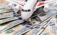 airplane on dollar bills close up