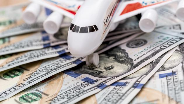 airplane on dollar bills close up