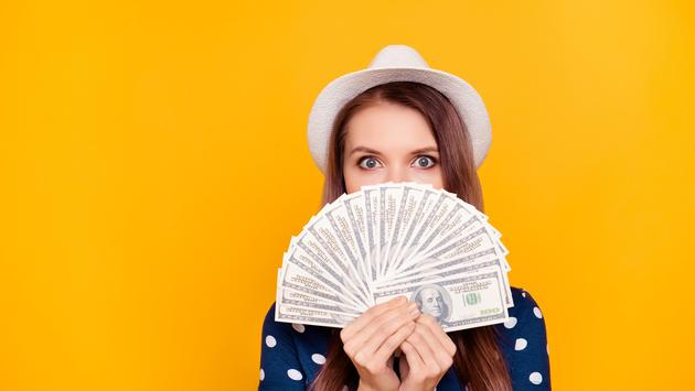 girl holding in hand a lot of money