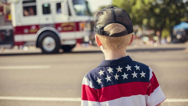 Young boy watching a Fourth of July parade