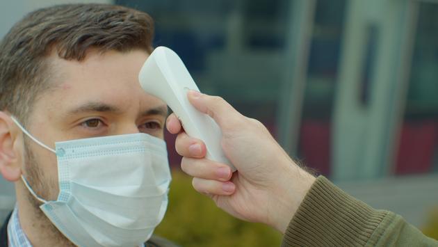 Man undergoing a temperature check