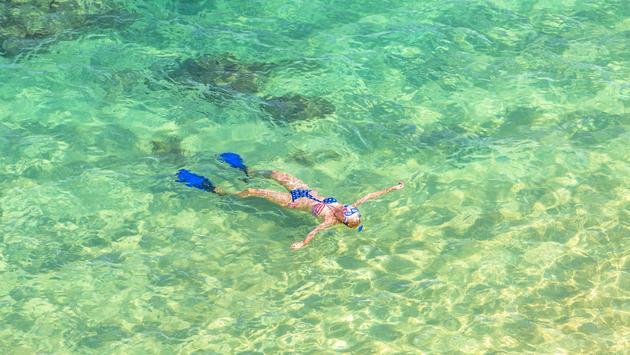 Female snorkeling in Hawaii