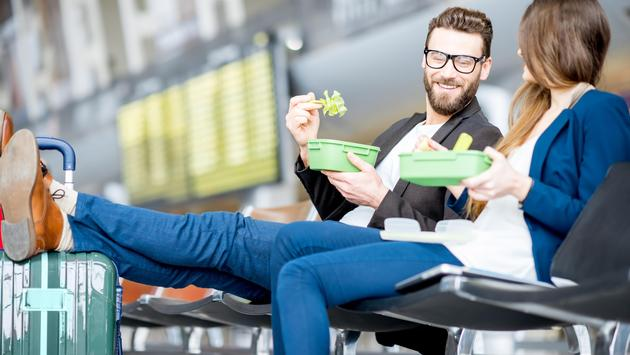 Couple eating at the airport
