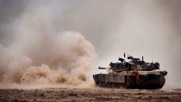 An M1A1 Abrams Main Battle Tank fires a round