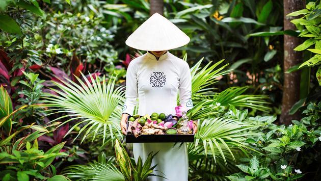A hotel worker in the garden of La Veranda Phu Quoc - MGallery, Vietnam.
