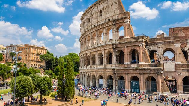 Colosseum with clear blue sky and clouds in Rome, Italy