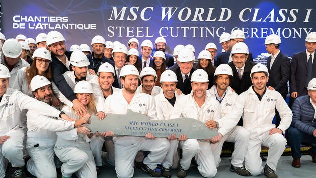 MSC Cruises new-build team poses with key executives from MSC Cruises and Chantiers de l'Atlantique.