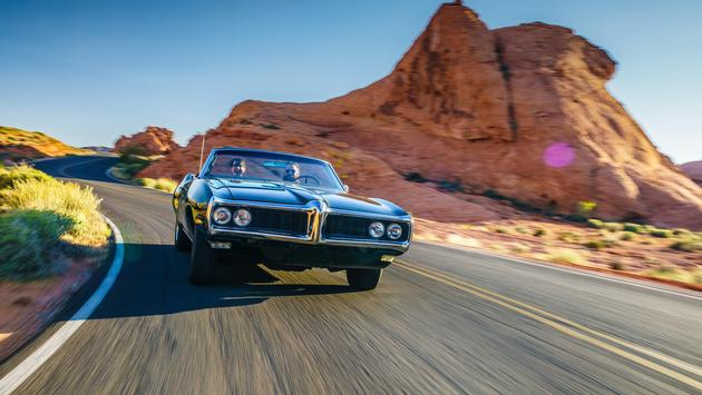 A couple driving through the desert
