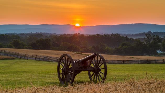 Sun rising behind artillery at Antietam National Battlefield