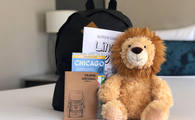 Plush lion with backpack and Chicago scavenger hunt booklet at Intercontinental Chicago