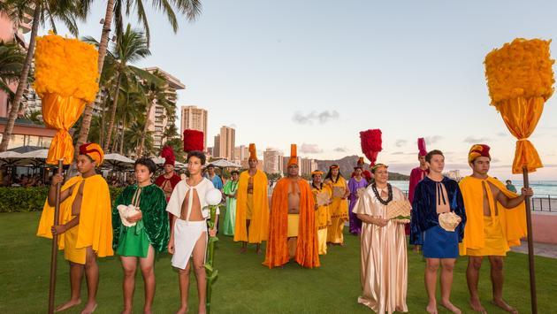 Aloha Festival court on Waikiki beach with traditional Hawaiian garb and kahili