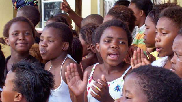 A group of South African children welcoming visitors