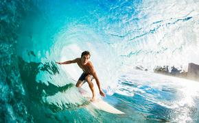 Close-up of a surfer in the tube getting barreled.