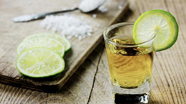 A shot of tequila with lime