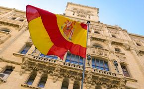The Spanish flag flying in front of a building in Madrid.
