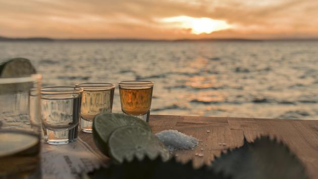Tequila shots by the sea at sunset
