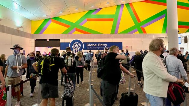 A view of Global Entry kiosks through a long line at Dallas Fort Worth airport