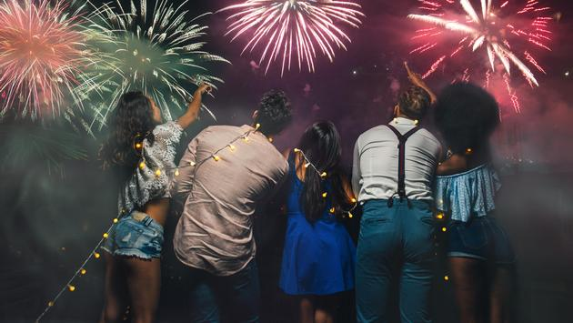 Group of friends watching fireworks from a rooftop in Miami