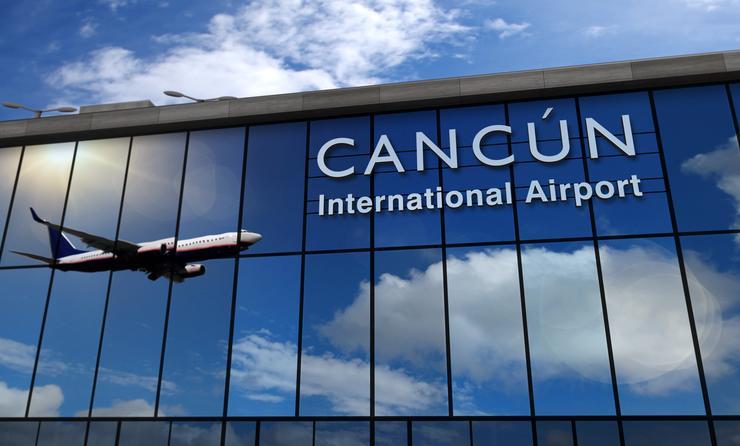 Airplane landing at Cancun airport.