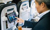 Alaska Airlines passenger using entertainment tablet