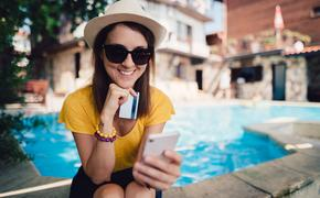 Woman booking travel from her phone