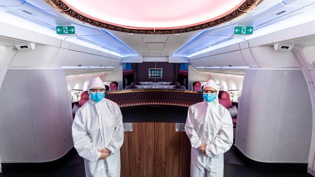 Qatar Airways' cabin crews don full-body personal protective equipment.