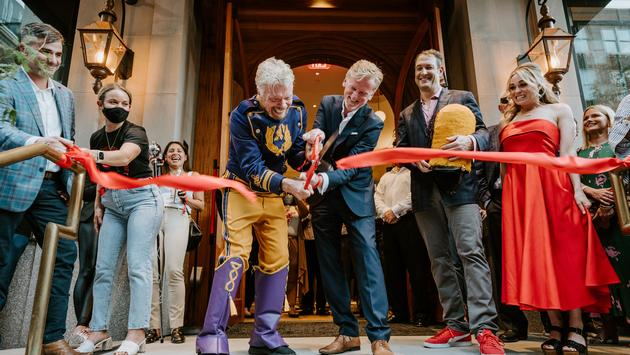 Sir Richard Branson and James Bermingham cut the ribbon to commemorate Virgin Hotels New Orleans' grand opening.