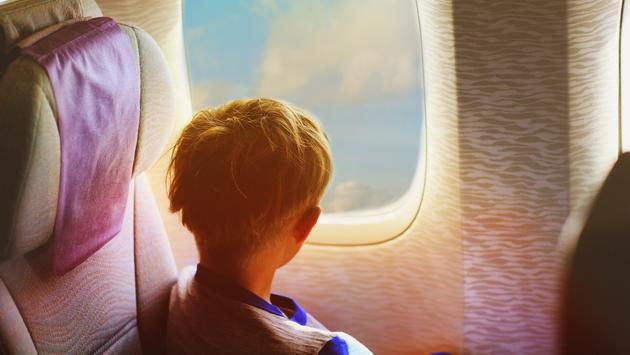 Young boy on an airplane flight