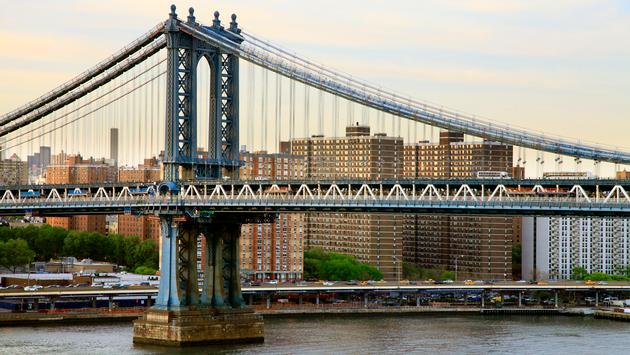 Manhattan Bridge New York City Skyline. (photo by: sansara/iStock/Getty Images Plus)