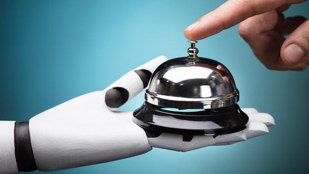 Robot holds a service bell.