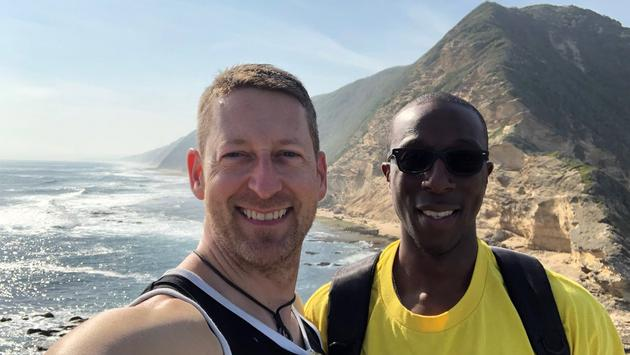 Paul Heney beach walk with partner and AMD in South Africa