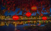 Lanterns and colorful lights on river in Hoi An, Vietnam