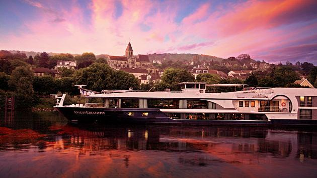 Avalon Creativity river cruise ship on the Seine River at Triel-sur-Seine, France