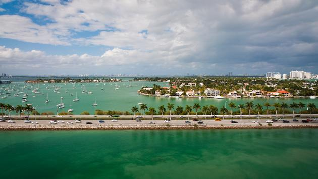 Bird's-eye view of MacArthur causeway, part of State Road A1A, and Palm Island in Miami, Florida