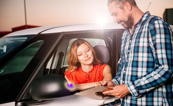 Woman reading car rental agreement