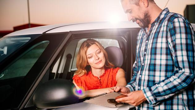 Woman reading car rental agreement