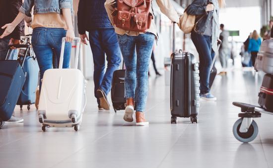 People walking through an airport terminal.