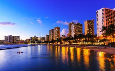 View of Honolulu and Waikiki Beach at night; Hawaii, USA
