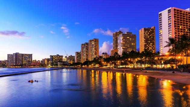 View of Honolulu and Waikiki Beach at night; Hawaii, USA