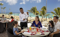 A family dining at Royalton Bavaro Resort & Spa