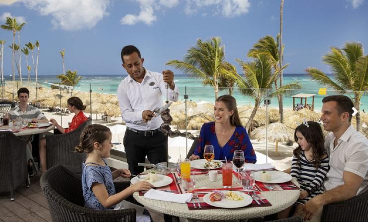 A family dining at Royalton Bavaro Resort & Spa