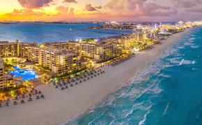 Sunset in Cancun. (Photo via iStock/Getty Images Plus/Jonathan Ross)
