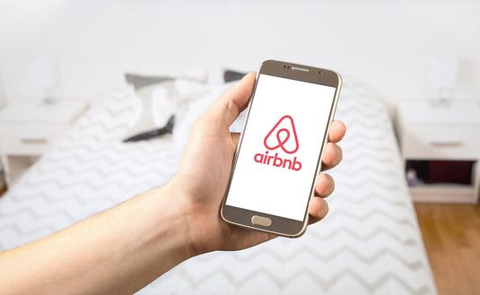 Airbnb logo on a smart phone screen